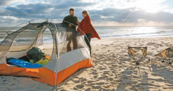 couple on beach camping